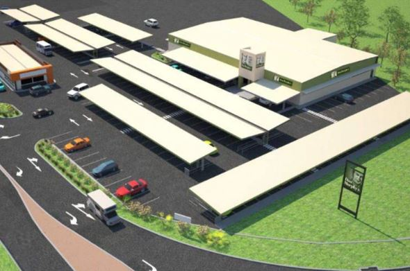 artist's impression of the proposed Dan Murphy's store near Darwin Airport - top down image of large white roof of store & covered parking & green grass & hedge area