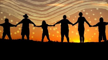 silhouette of 6 people standing stretched out holding hands against sunset coloured landscape with Aboriginal dot painting symbols