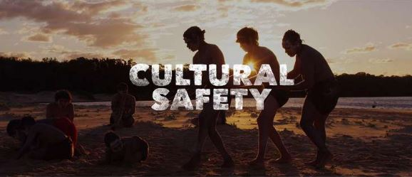 5 Aboriginal people on country at dusk overlaid with text 'cultural safety' white font