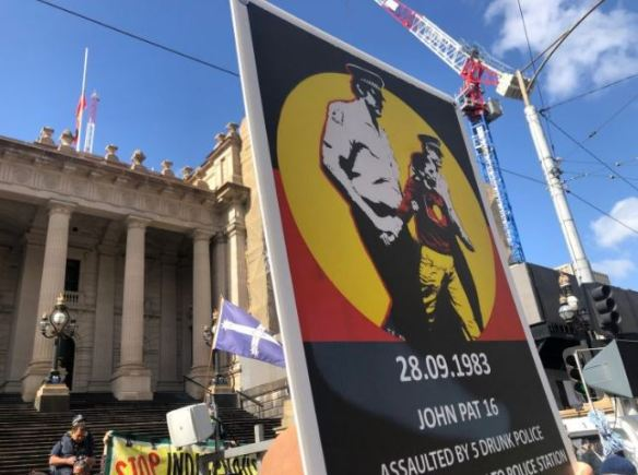 large sign at Melbourne RCIADIC 30 Years rally text '28.9.83 John Pat 16 assaulted by 5 drunk policy...'