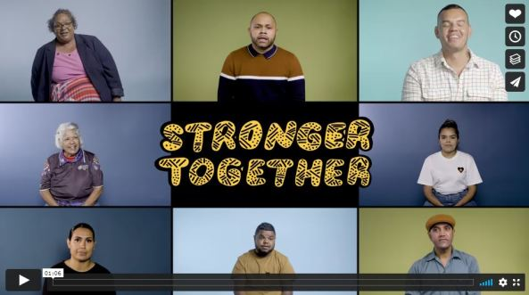 screen shot from Stronger Together vimeo video, rectangular tile made up of portrait shots of 8 Aboriginal people with text 'stronger together' in the cetre