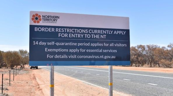 NTG road sign re border restrictions due to COVID-19