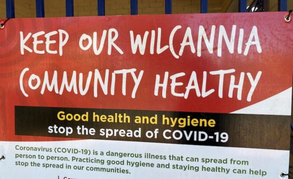 sign text 'keep our Wilccania community health - good health and hygiene stop the spread of COVID-19'