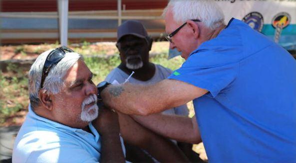 Aboriginal man receiving covid-19 vaccination