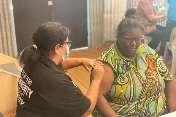 Aboriginal female elder receiving covid-19 vax