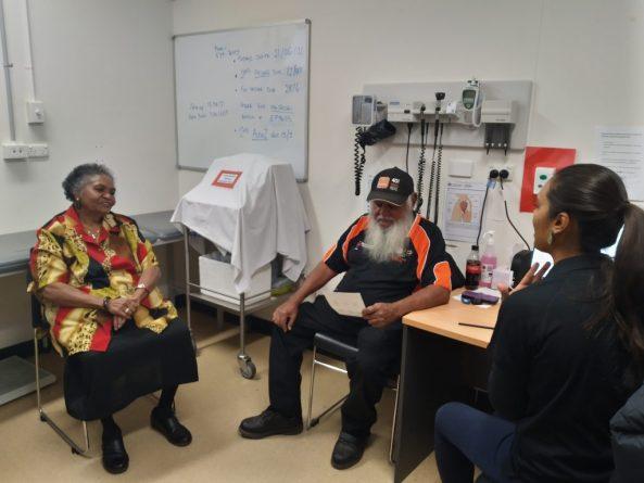 Eileen Hoosan and Geoff Shaw talk to Central Australian Aboriginal Congress doctor Jessica Johannsen. Image source: CAAC.