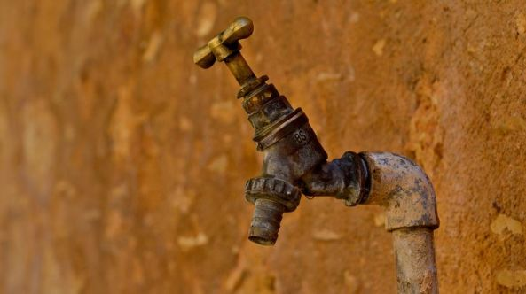 old broken water tap in outback
