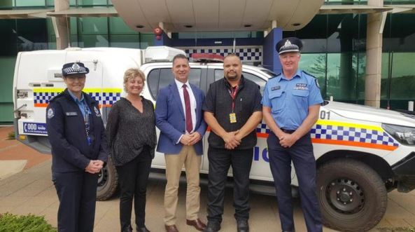 Assistant Commissioner Jo McCabe, Geraldton MLA Lara Dalton, Police Minister Paul Papalia, Aboriginal Health Worker Chris Fitzgerald and Mid-West Gascoyne Supt Roger Beer standing in front of a paddy wagon in front of police station