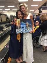 An Yuhua and her Rep Sally with a photo from Graudation and a painting for Sally from An