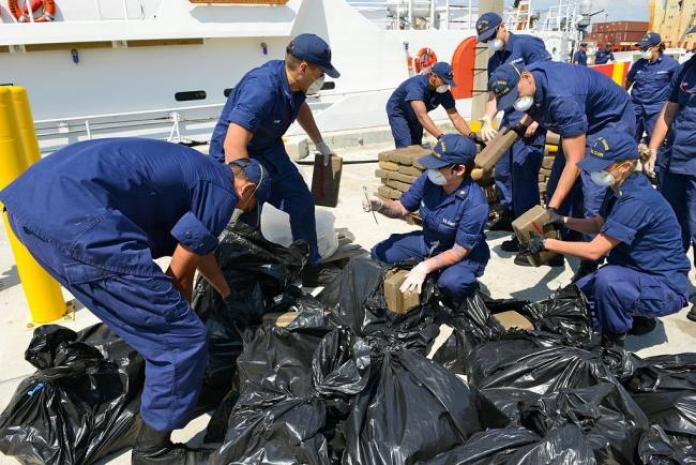 The U.S. Coast Guard offloads seized cocaine in Miami Beach, 2014 (Photo by Sabrina Laberdesque/Wikimedia)