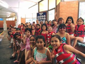 Children in a group at swimming lessons