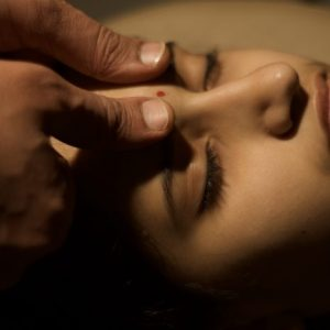 woman undergoing Marma Chikitsa Restorative and Healing Therapy - yoga professionals