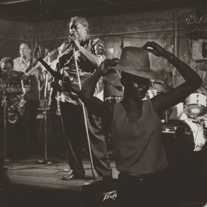 Rest in Peace and Blues Mr. B.B. King. A copy of this photo hangs in our home, a wedding present from the photographer, Bill Steber. It shows B.B. playing at Club Ebony near his hometown in Mississippi. The look of sublime pleasure on the dancer's face was B.B. King's gift to all of us.