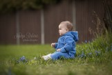 Sitting toddler portrait with blue flowers