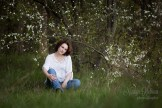Romantic young woman portrait in Riga with blooming cherry tree