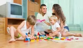 Parents playing with their kids - NAET Dubai