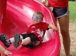 Kid on slide