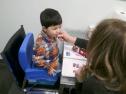 child and teacher working on speech