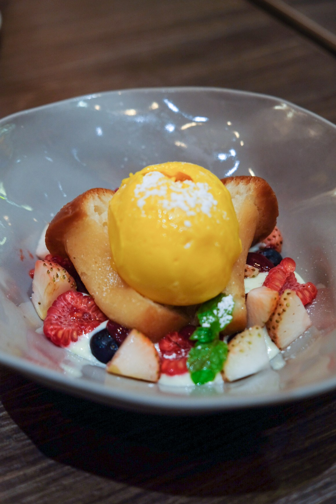 Delicious Italian Food At Amo Restaurant - Lemon Baba with Custard, Mango Sorbet and Mixed Berries ($15)