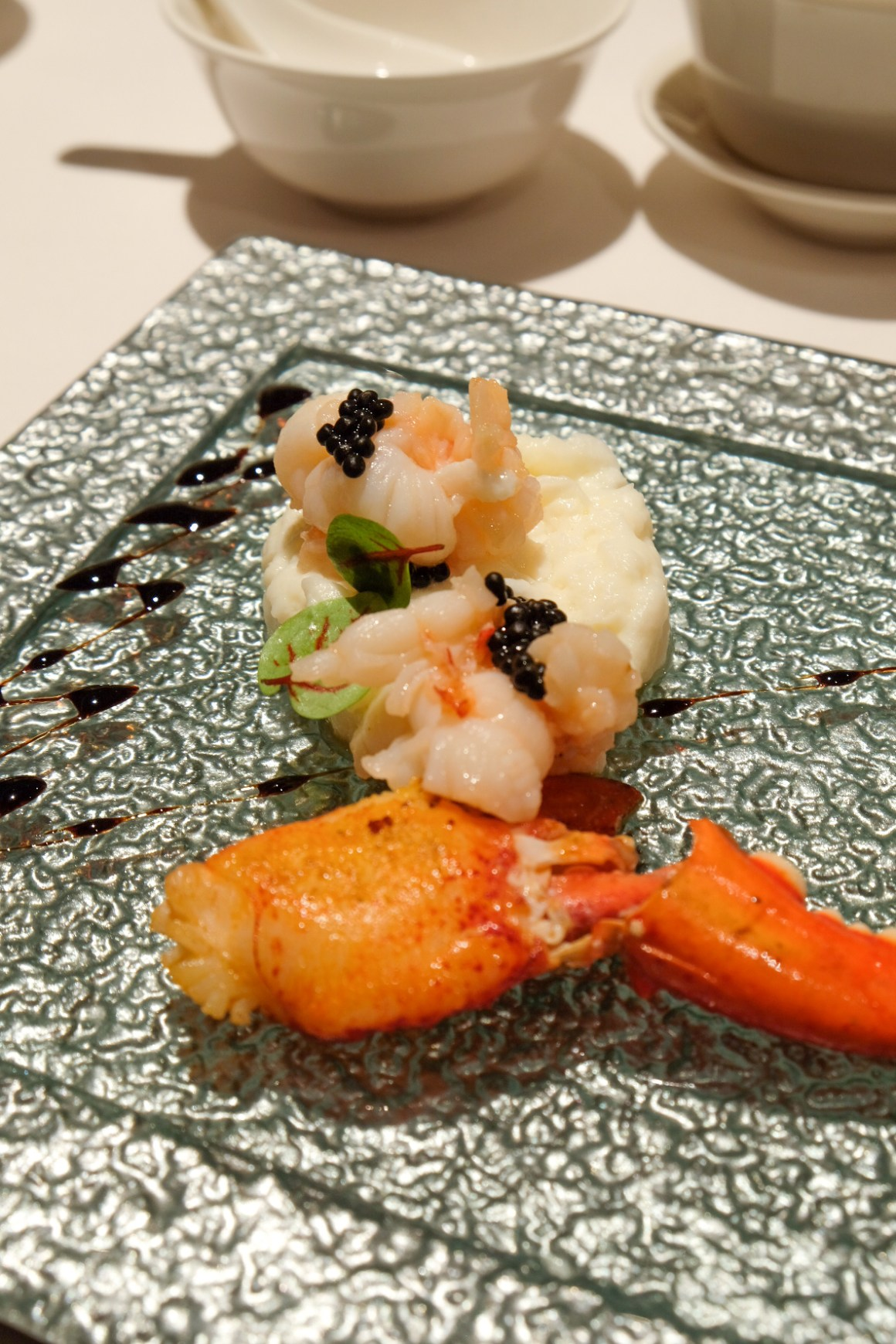 Wok-fried Boston Lobster with Caviar, Egg White, Fresh Milk & Broccoli