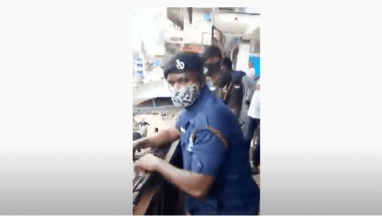 Ghanaian policemen harass and close a Nigerian businessman's shop over $1m tax (video)
