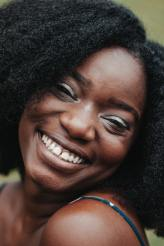 """Bold African Lady Smiling while Rocking her Natural Hair Tagged Under the Post """"African New Haristyle"""""""