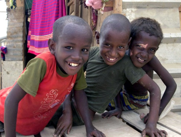 SF: Stock Photo Showing 3 Boys of Different Race in Djibouti smiling at the camera | Used on Nahwewe.com for Want to Know Africa? Djibouti, Horn of Africa