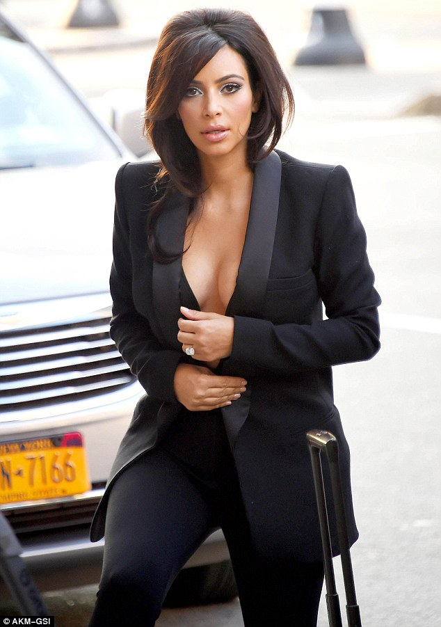 Kim Kardashian Walks Without A Bra With Daughter North