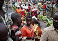 Boys look on as they sell bananas in an open market in a village near Bujumbura, June 1, 2015. REUTERS/Goran Tomasevic
