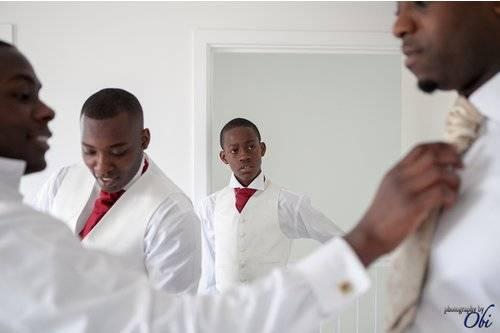 groom and groomsmen tying ties