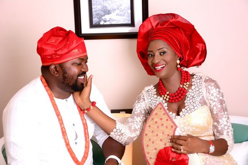 couple in red-themed traditional wedding picture