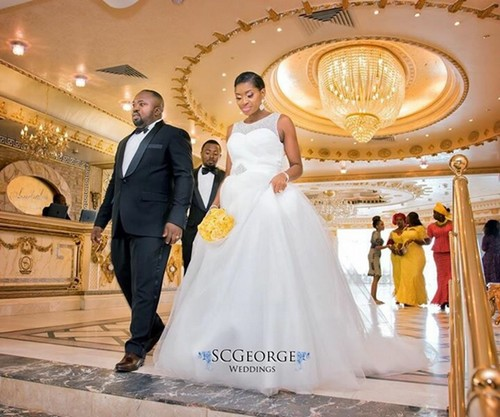 couple at yellow themed Nigerian white wedding