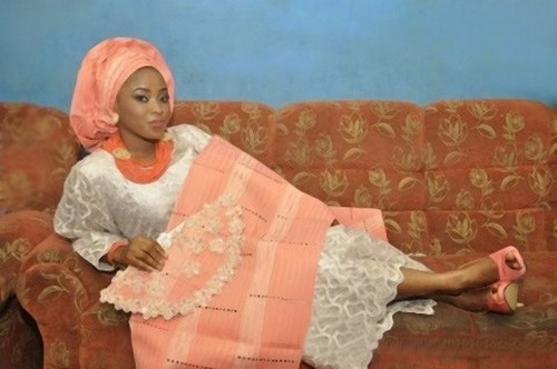 bride in orange-white traditional wedding attire