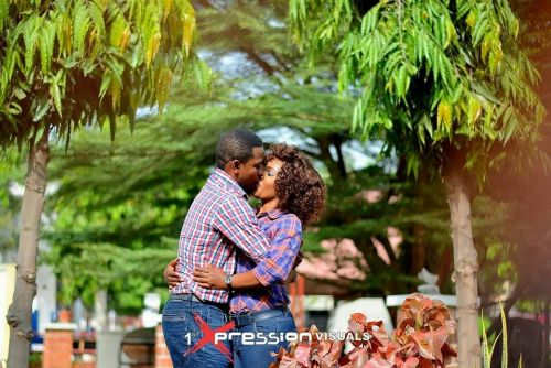 couple kisses in jeans denim themed pre-wedding picture