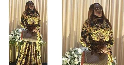 Picture of a lady standing up on her own funeral goes viral (Photo)