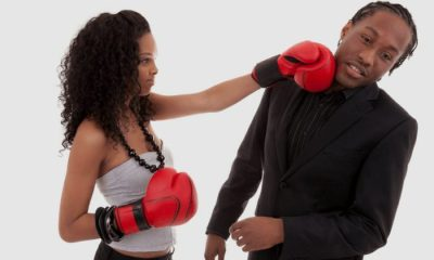 young-black-woman-fighting-with-her-boyfriend-boxing-gloves-750