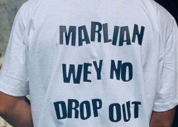 """""""Marlian Wey No Drop out"""" - Poco Lee signs out from School."""