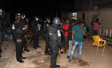 Photo of Lockdown: Bar owner and his customers arrested for violating lockdown order in Lagos (photos)