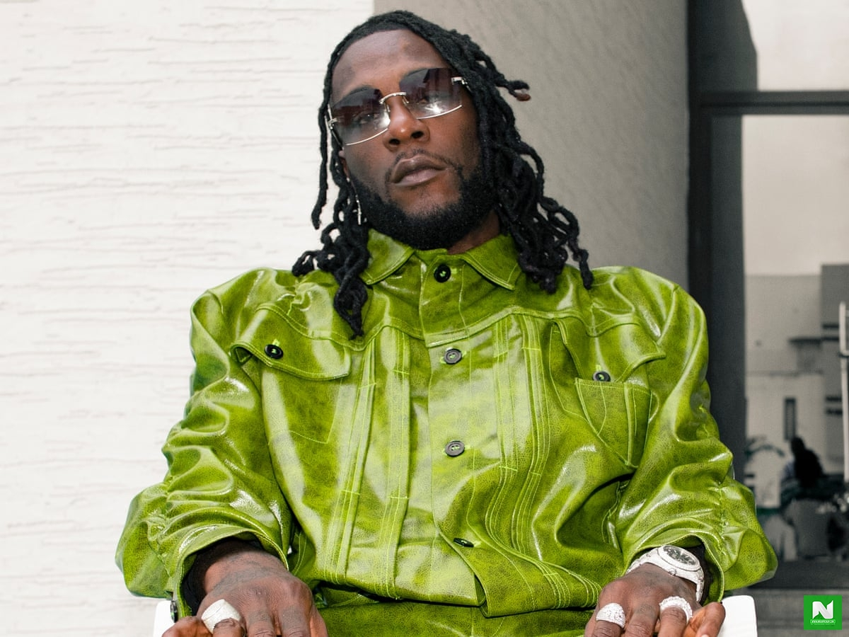 Burna Boy Reacts To Video Of Oxlades Manager Being Dragged On The Floor Like A Dog By Police