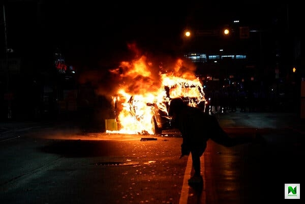 At least one police car was set on fire during the protests.