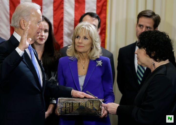 Jill Biden holds the Biden family Bible as then-Vice President Joe Biden takes the oath of office on Jan. 20, 2013, in Washington.