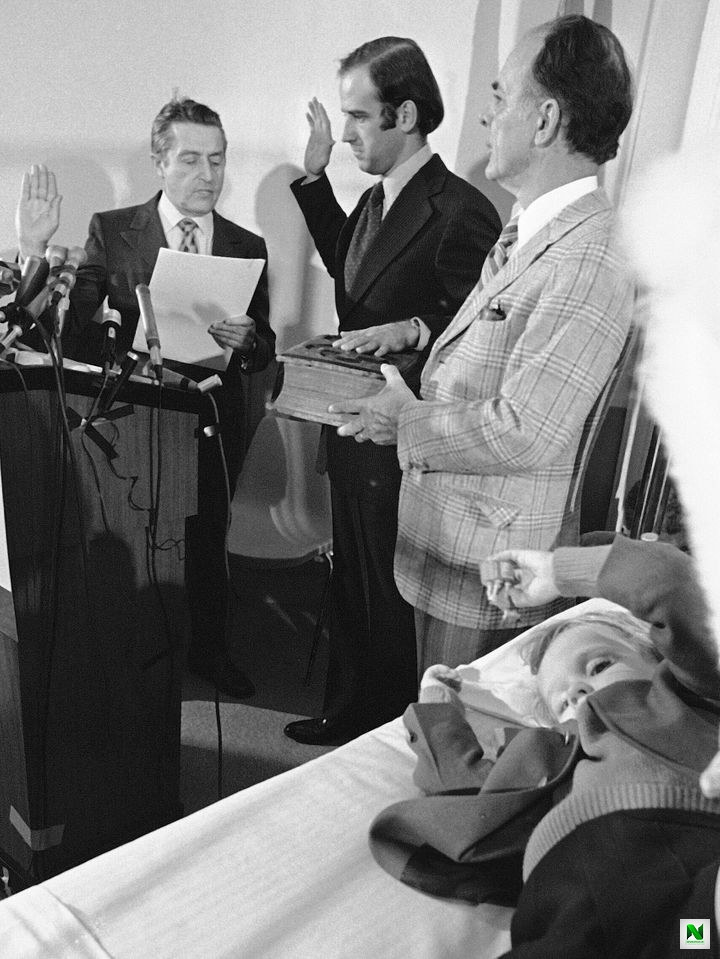 Joe Biden, center, is sworn in as a senator from Delaware at a Wilmington hospital on Jan. 5, 1973. Four-year-old Beau Biden, foreground, was injured in an accident that killed his mother and sister a week before Christmas. His 2-year-old brother, Hunter, was also injured.