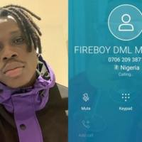 Fireboy DML fans go crazy after the YBNL art dropped his number online.