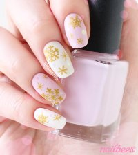 Gold Snowflakes on Matte Pink and White Nails | nailbees