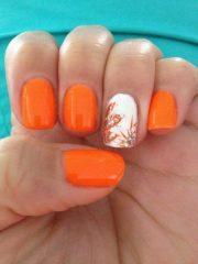 vibrant orange nail design