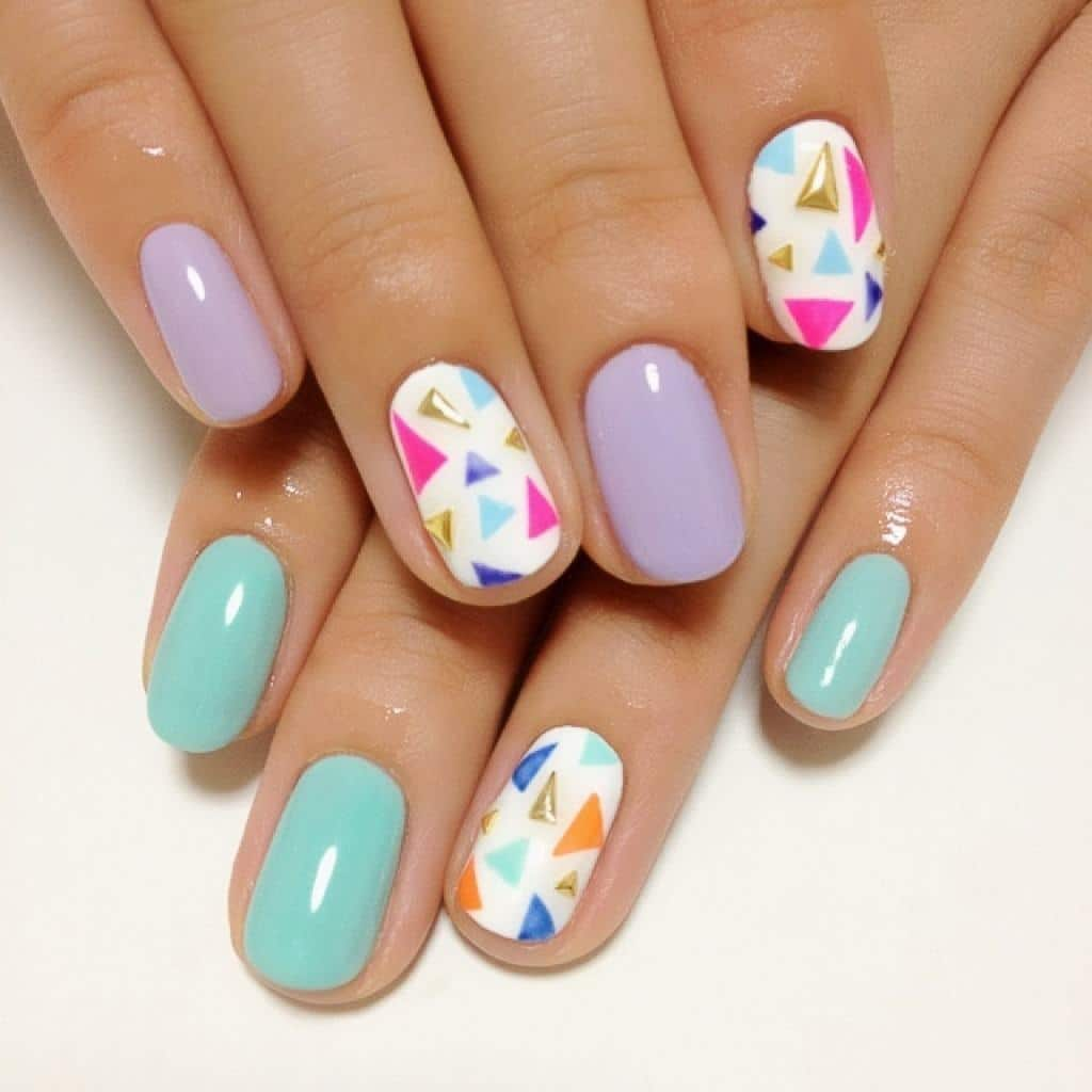 Unlike All Other Spring Nail Designs This One Does Not Contain Any Squares Swirls Flowers But Triangles Apply A Unique Color Of Polish On