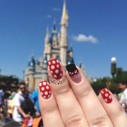 minnie mouse nails in front of
