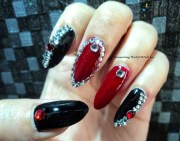 red and black bling stiletto nails