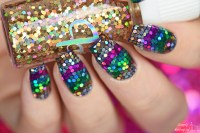 Rainbow holo glitter placement nail art by