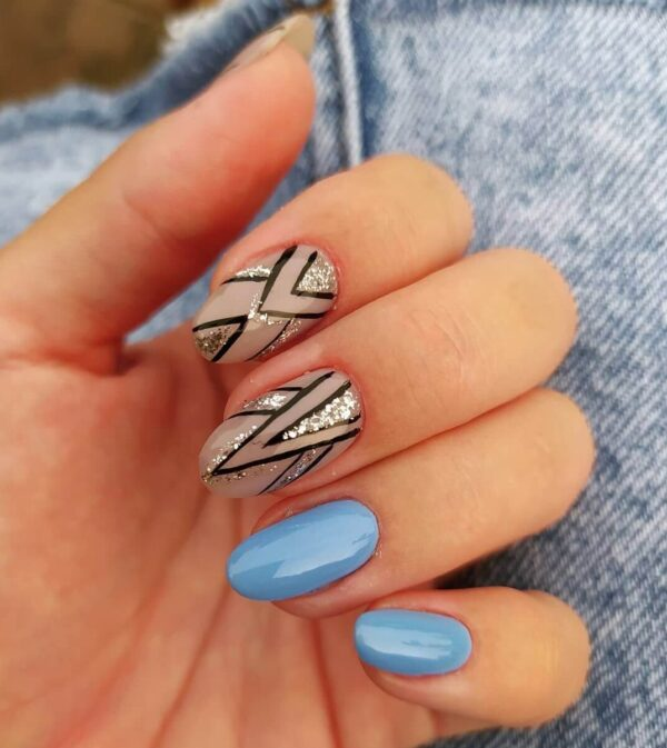 Blue manicure and patterns with sparkles